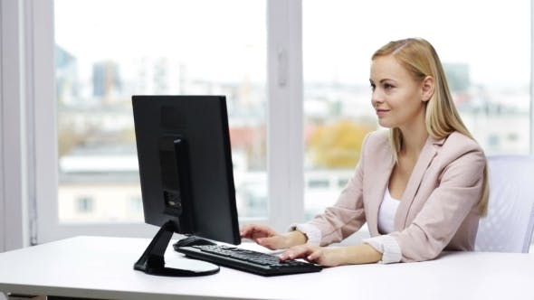 Thumbnail for Happy Businesswoman With Computer Typing At Office