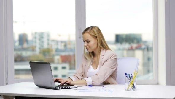 Thumbnail for Smiling Businesswoman With Laptop And Papers