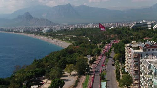 Antalya City And Beach With Turkey And Antalya Flags Aerial View