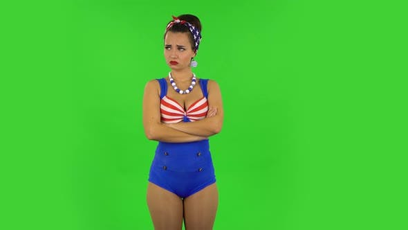 Thumbnail for Beautiful Girl in a Swimsuit Is Very Offended and Looking Away Then Smiling. Green Screen