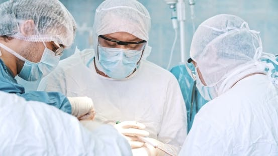 Thumbnail for Team Of Surgeon In Uniform Perform Operation
