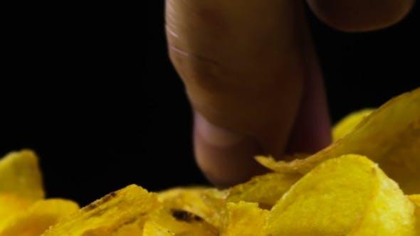 Thumbnail for Potato Chips Rotating On Black Background