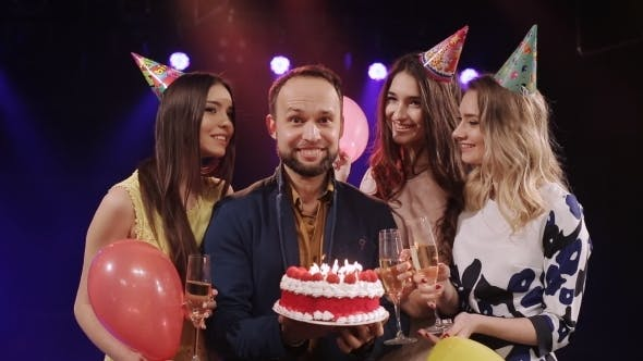 Thumbnail for Birthday Lit Candles On The Cake And Friends Posing