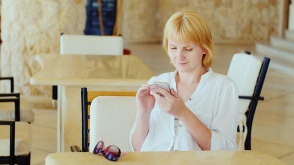 Cover Image for Attractive Woman Using a Mobile Phone
