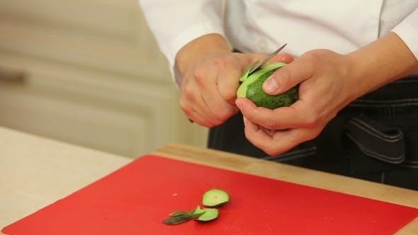 Thumbnail for Chef Is Peeling Avocado