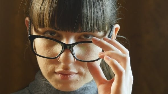Thumbnail for Portrait Young Serious Woman Wearing Glasses