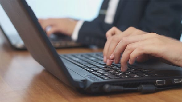 Thumbnail for Business People Typing on Laptop