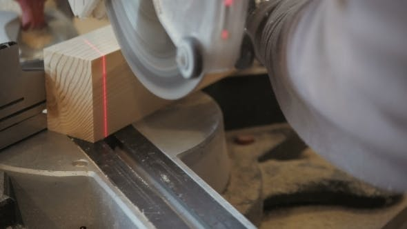 Thumbnail for Carpenter Cutting Plank Wood By Circular Saw