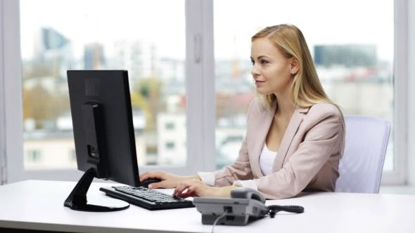 Thumbnail for Smiling Businesswoman With Computer And Telephone