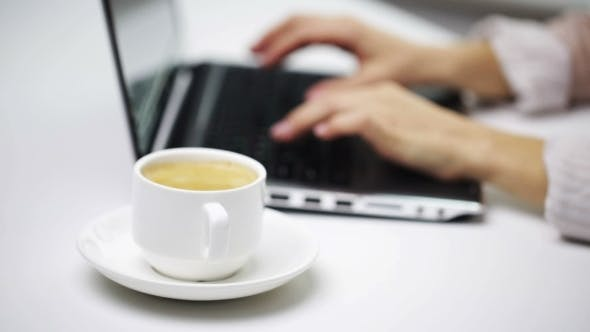 Thumbnail for Businesswoman With Laptop And Coffee At Office