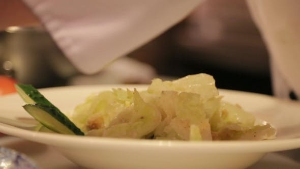 Thumbnail for Chef Decorates Salad With Slices Of Chiken