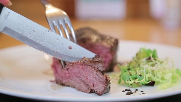 Thumbnail for Cutting Red Meat On a Plate