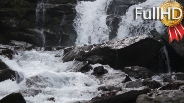 Cover Image for Fast Flowing Water in a Waterfall During Winter