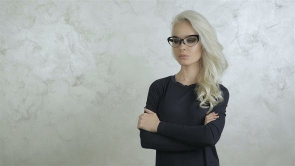 Thumbnail for Serious Attractive Young Woman With Glasses
