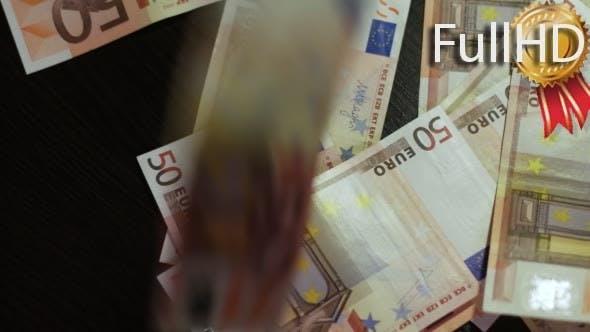 Counting Euros. Euro Banknotes Falling Down