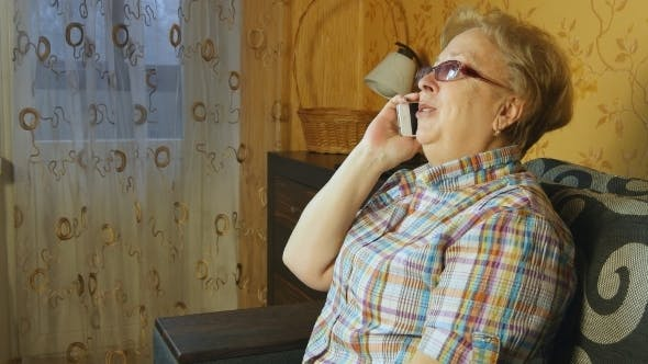 Thumbnail for Mature Woman Talking On Cell Phone