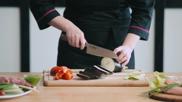 Thumbnail for Professional Chef Cutting Eggplant