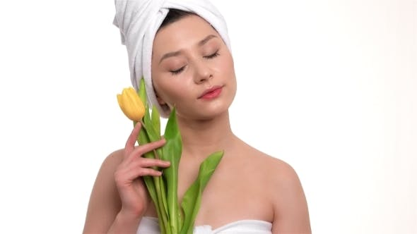 Thumbnail for Beautiful Girl With a Towel On Head Holds Yellow Tulips
