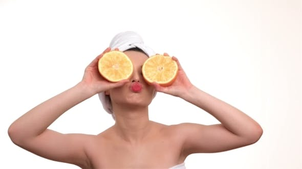 Thumbnail for Beautiful Woman Holding Orange Slices In Front Of Her Eyes