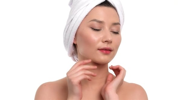 Thumbnail for Beautiful Girl On White Background After Bath Touching Her Face