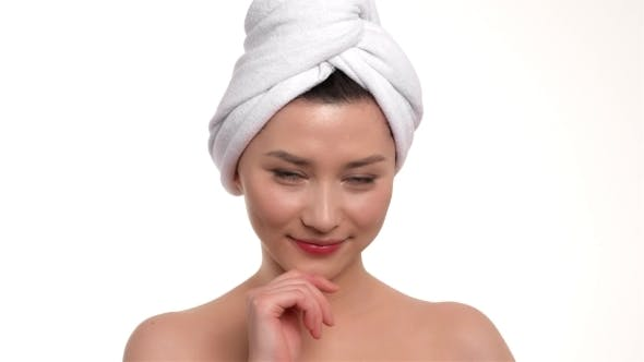 Thumbnail for Smiling Beautiful Shy Girl With a Towel On Her Head