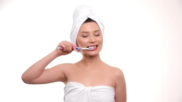 Thumbnail for Shot Of Woman Brushing Her Teeth On White Background