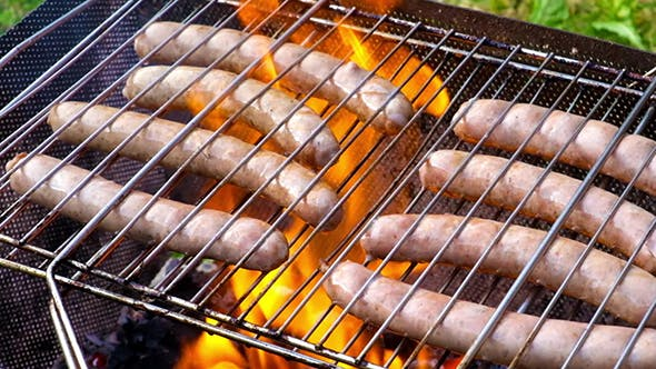 Thumbnail for Bratwurst Sausages Cooking On A Wood Barbecue
