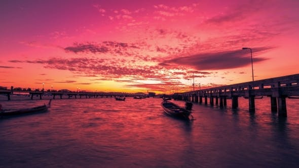 Thumbnail for . Boats On The Pier Chalong During a Red Dawn Sunrise In Phuket