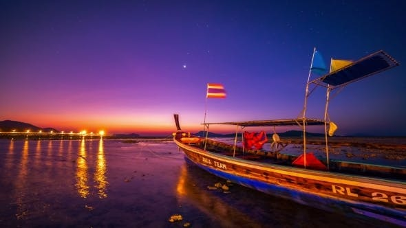 Cover Image for Dawn In The Sea Against The Backdrop Of a Fishing Boat In Phuket