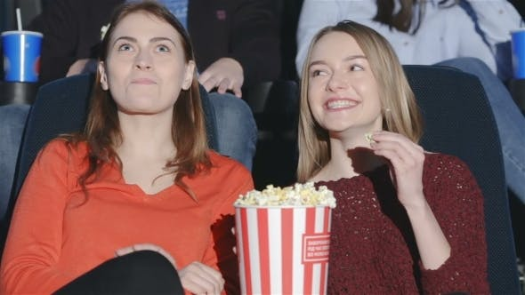 Thumbnail for Teens Are Chewed Popcorn With Soda And Enjoy Movies