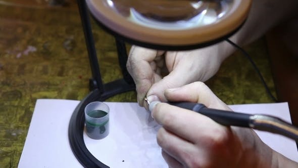 Thumbnail for Jeweler Polishing Gold Ring