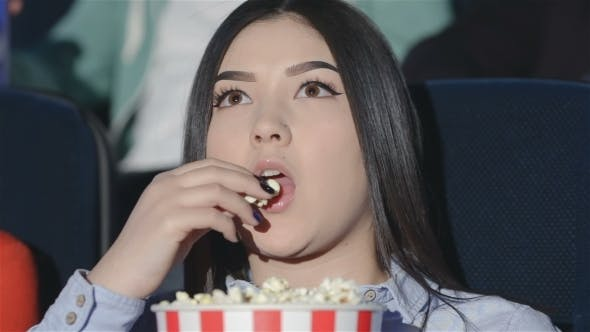 Thumbnail for Asian Girl With a Bucket Of Popcorn