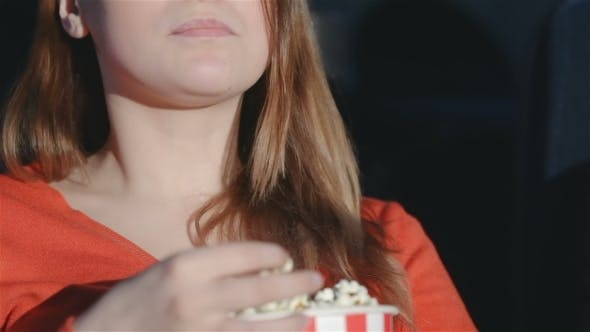 Thumbnail for Girl Chewing Popcorn