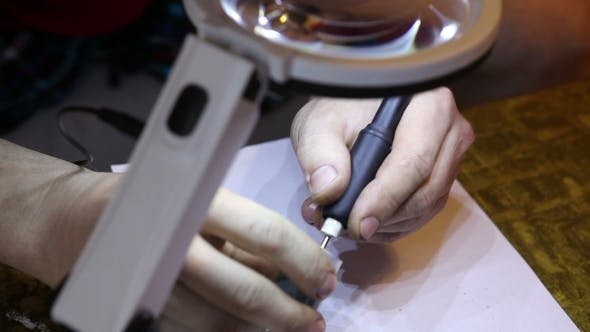 Thumbnail for Jeweler Polishing Gold Ring With