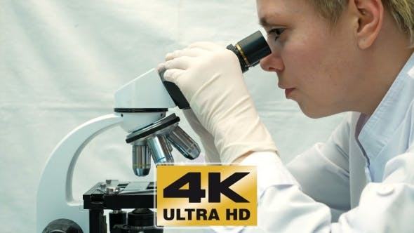 Thumbnail for Female Doctor Scientist Looking Through Microscope