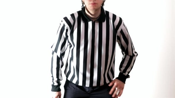 Thumbnail for An Ice Hockey Referee Is Standing