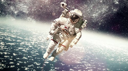 Astronaut In Outer Space Against The Planet Earth
