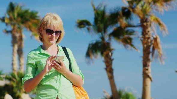 Thumbnail for Woman In Summer Clothes Typing On Your Phone
