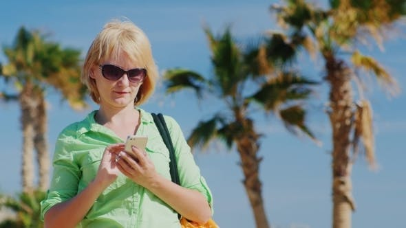 Thumbnail for A Tourist Wearing Glasses And a Bag Over His Shoulder SMS