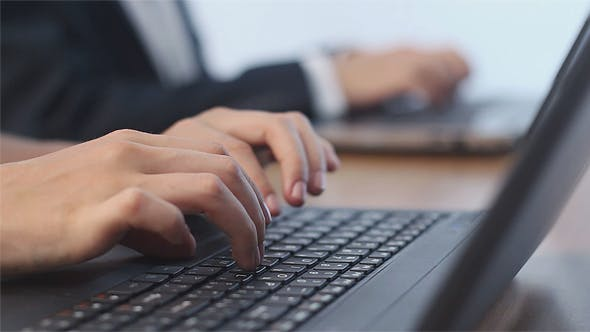 Thumbnail for Business People Typing on a Laptops