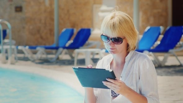 Thumbnail for Woman In Sunglasses Enjoys The Tablet Pool