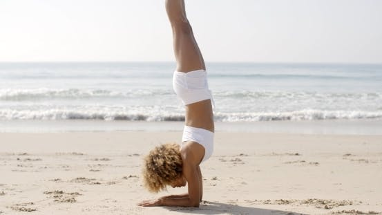 Thumbnail for Woman Practicing Yoga On The Beach
