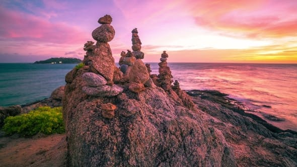 Thumbnail for Sunset On The Background Pyramids Of Stones in Phuket, Thailand