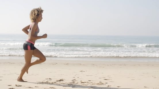 Thumbnail for Woman Running On The Beach
