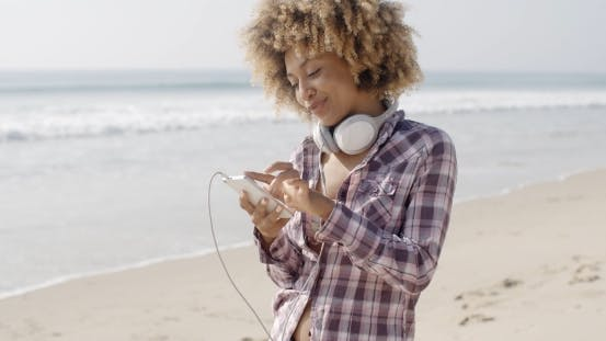 Thumbnail for Girl On Beach Listening To Music