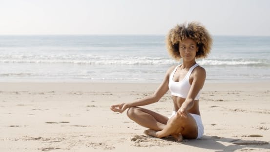 Thumbnail for Woman Meditating On Beach In Lotus Position