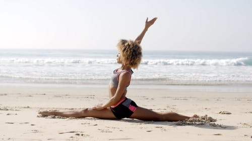 Woman Doing Twine On The Beach