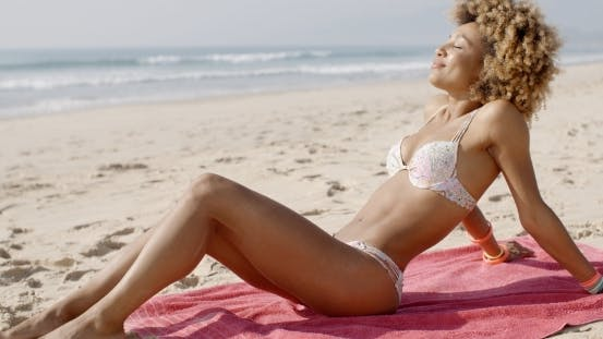 Thumbnail for Beautiful Woman Sunbathing On A Beach