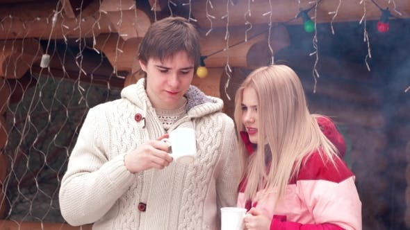 Thumbnail for Beautiful Couple Drinking Coffee In Winter