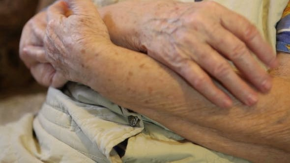Thumbnail for The Folded Hands Of The Elderly Woman